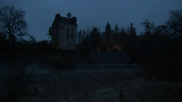 night shots of abergeldie castle clear up operation scotland aberdeenshire gvs diggers refilling the riverbank with rocks to bolster flood defences /... - nackenrolle kopfkissen stock-videos und b-roll-filmmaterial