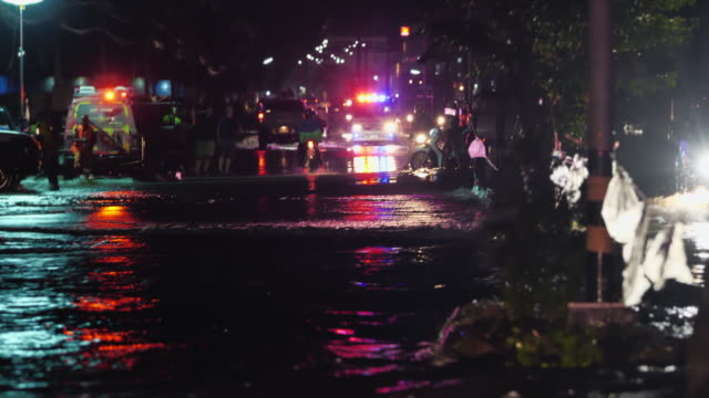 flooding night with ambulance cars. - rescue stock videos & royalty-free footage
