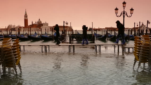 4k flooding on st. marc's square in venice, italy - toned image stock videos & royalty-free footage