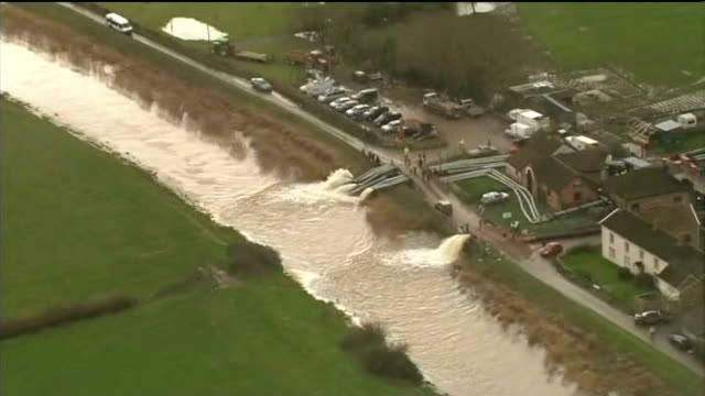 owen paterson criticised during visit to somerset air view / aerial northmoor pumping station showing extra pipework pumping floodwater back into... - オーウェン・パターソン点の映像素材/bロール