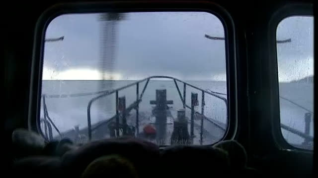 Politicians blame each other as storms continue ENGLAND Cornwall Newlyn EXT GVs of fishing boats from Penlee lifeboat as it moves out of harbour...