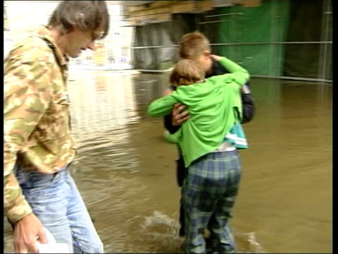 prague under threat; itn czech republic: prague: ext police officer lifting woman from dinghy after rescuing her from flood gv people evacuated on... - prague stock videos & royalty-free footage