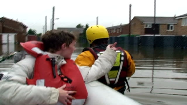 report on one family in south yorkshire ext clair lewis in rescue dinghy being pulled along by rescuer - south yorkshire stock videos and b-roll footage