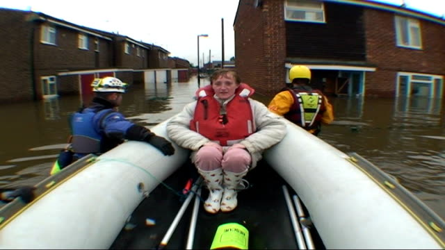 report on one family in south yorkshire sequence clair in rnli dinghy being pulled through floodwater to her house - south yorkshire stock videos and b-roll footage