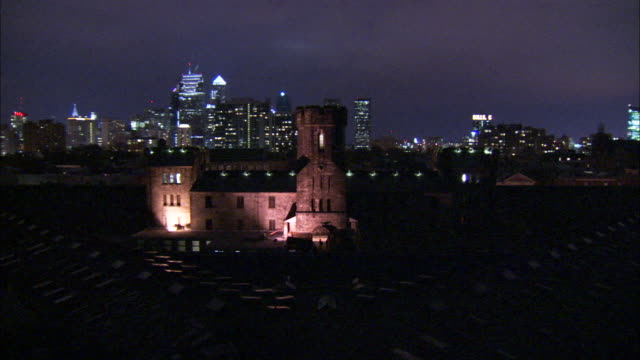 floodlights illuminate the eastern state penitentiary. available in hd - eastern state penitentiary stock videos & royalty-free footage