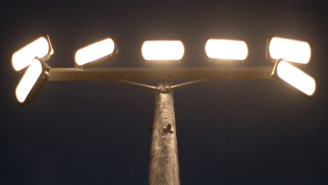 floodlights turning on - pole stock videos & royalty-free footage