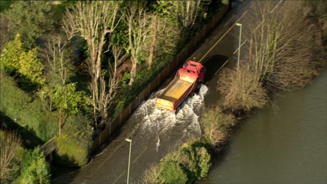 Aerials of RiverThames from Central London through West London and Buckinghamshire Surrey Sunbury on Thames / flooded houses / Sunbury Lock /...