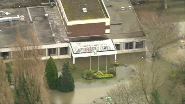 Aerials over Thames Valley AIR VIEWS AERIALS Holiday Inn Walton on Thames surrounded by water / More GVs of flooded Walton on Thames