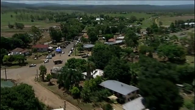 floods aftermath; australia: queensland: grantham: ext air view small town seen from air grantham hotel sign and hotel with pile of bricks and rubble... - rubble stock-videos und b-roll-filmmaterial