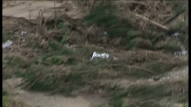 air views / aerials white car amongst trees and flood debris - destruction stock videos & royalty-free footage