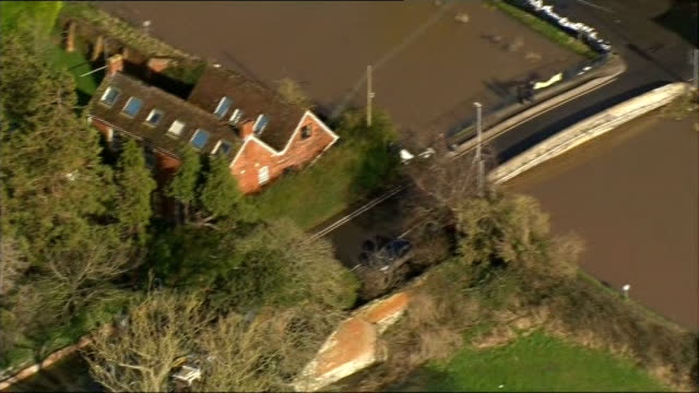 air views of somerset levels burrowbridge burrow mump ruin on hilltop surrounded by flood water / flooded bridge over overflowing river / people and... - somerset levels stock videos and b-roll footage