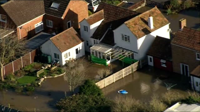 air views of somerset levels england somerset moorland flooded fields and countryside surrounding village / house and lawn surrounded by earth bank... - somerset levels stock videos and b-roll footage