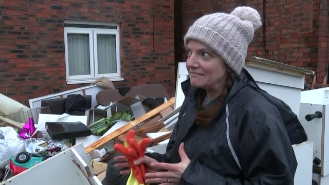 Amir Khan visits flood victims EXT Flood victim Sarah Betton out of her house and looking at flood damaged household items in front garden Sarah...