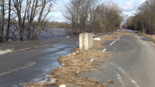 floods close the a19 between eggborough and chapel haddlesey as floods hit east yorkshire plus shots of a flood plain behind the village of gowdall - keypad stock videos & royalty-free footage
