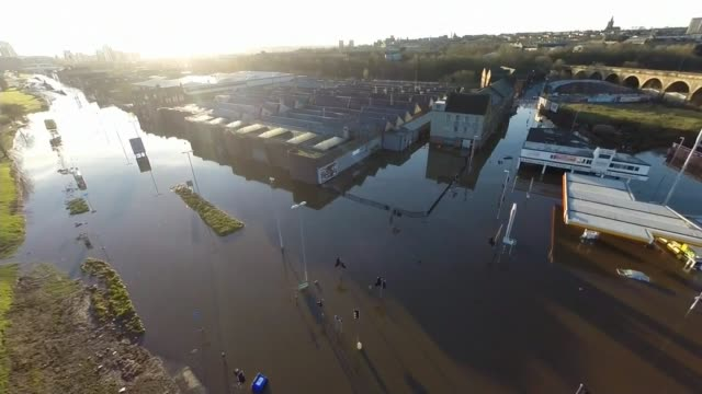 vídeos y material grabado en eventos de stock de communities furious as left unprotected by funding cuts; yorkshire: air view over flooded road - channel 4 news