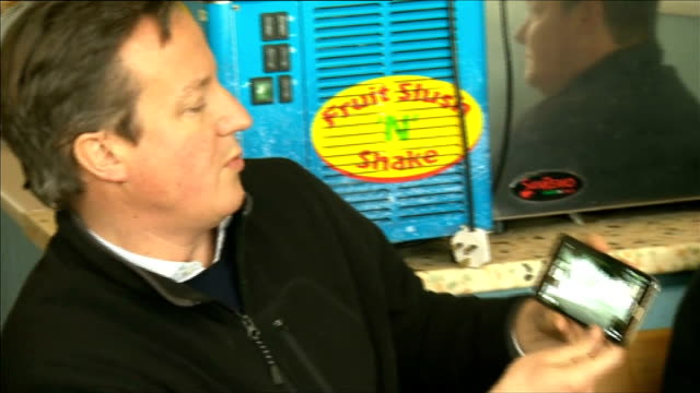 david cameron visits flood victims in kingsand cornwall england cornwall kingsand ext david cameron mp along with woman in green coat david cameron... - kingsand video stock e b–roll
