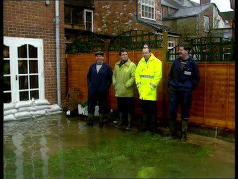 floods; england gloucs gloucester tlms side boat moored on flooded river severn group of residents standing outside house tms sandbags piled up by... - three quarter length stock videos & royalty-free footage