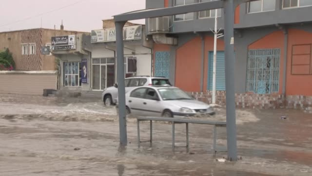 floods fill the streets of nouakchott, mauritania after torrential overnight rains, leaving entire neighborhoods isolated and halting cars on the... - mauritania stock videos & royalty-free footage