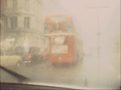 Floods following severe thunderstorms ENGLAND London S POINT OF VIEW shot of double decker bus seen through window DRIVER'S POV shot of people...