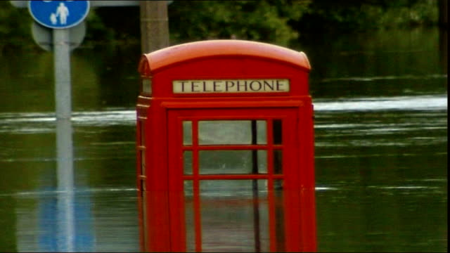 progress one year on june 2007 south yorkshire catcliffe flooded streets and submerged telephone box - south yorkshire stock videos and b-roll footage
