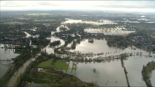 river thames floods between datchet and shepperton thames valley flooded river and submerged surrounding countryside holiday inn walton on thames... - inn river stock videos and b-roll footage