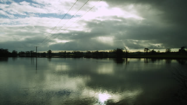 floodwater covers fields, upton-upon-severn, worcestershire, england - telephone pole stock videos & royalty-free footage