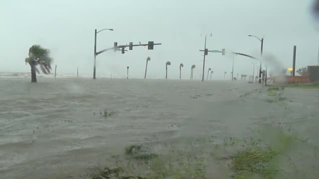 floodwater of hurricane isaac ripples over a street in gulfport, mississippi. - tropical storm stock videos & royalty-free footage