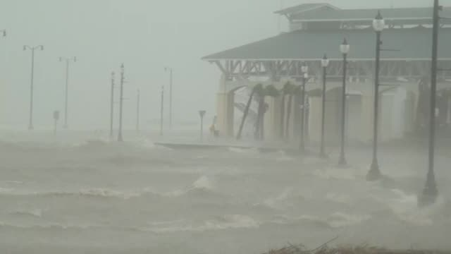 floodwater rushes over streets and past lampposts as hurricane isaac hits gulfport, mississippi. - tropical storm stock videos & royalty-free footage