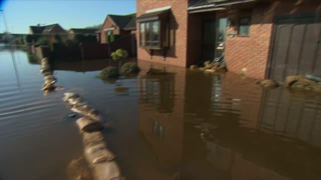 floodwater slowly going down a drain in east cowick - house stock videos & royalty-free footage