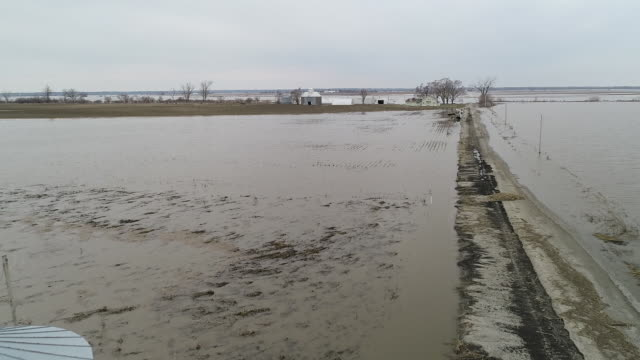 vídeos de stock e filmes b-roll de floodwaters from the missouri river cover the ground in southwest iowa in sidney iowa united states on march 22 and pacific junction iowa on saturday... - southwest usa