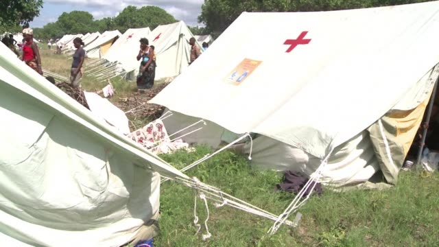 floodwaters that have inundated southern mozambique on saturday reached the tourist hub of xai xai forcing the closure of a major north south road a... - major road stock-videos und b-roll-filmmaterial