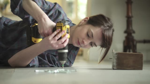 floor drill woman - diy stock videos and b-roll footage