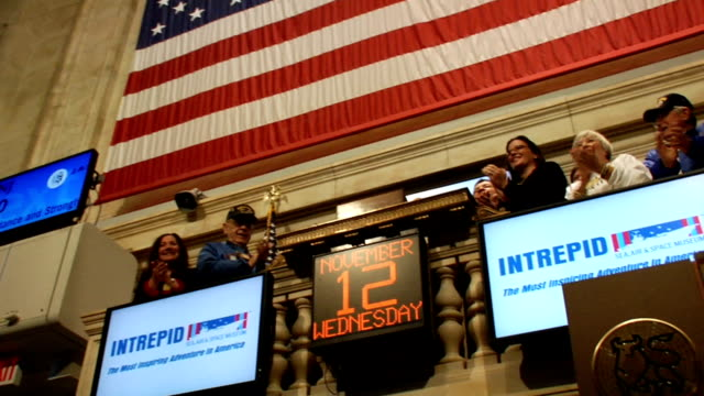 floor level looking up to balcony while ringing of opening bell at new york stock exchange new york city - new york stock exchange bildbanksvideor och videomaterial från bakom kulisserna