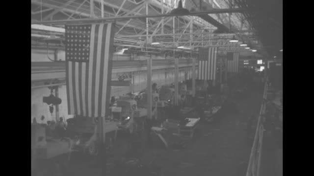 LS floor of Lockheed airplane factory in Burbank CA during warplane production / MS workers working on almost completed F38 Interceptor / MS workers...