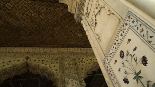 floral artwork detail in marble pavilion. - mughal empire stock videos and b-roll footage