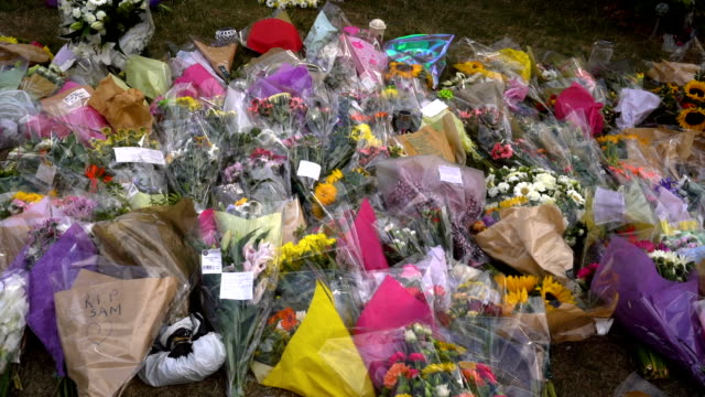 floral tributes lay outside the university of north staffordshire hospital where murdered midwife samantha eastwood worked on august 9 2018 in stoke... - trauerzeit stock-videos und b-roll-filmmaterial