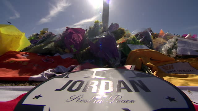 floral tributes left for jordan banks, the nine year old boy who died after being struck by lightning whilst playing football in blackpool - thunderstorm stock videos & royalty-free footage