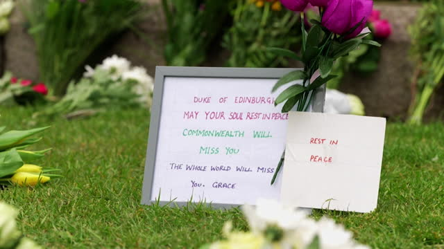 floral tributes left outide windsor castle following the death of prince philip, duke of edinburgh - monument stock videos & royalty-free footage