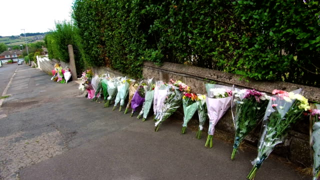 stockvideo's en b-roll-footage met floral tributes stand outside the home of murdered midwife samantha eastwood in greenside avenue on august 9 2018 in stoke on trent england midwife... - human interest