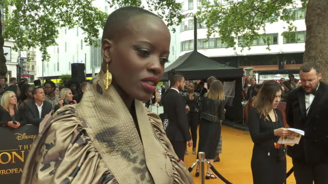 vídeos de stock e filmes b-roll de interview florence kasumbaactress on the live action version of the film on her career after black panther and how black panther 2 is progressing at... - meghan markle lion king