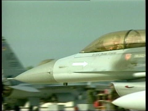 Florida SEQ F16 fighter jets taxiing on tarmac at air base GROUND TO AIR F16 away after take off