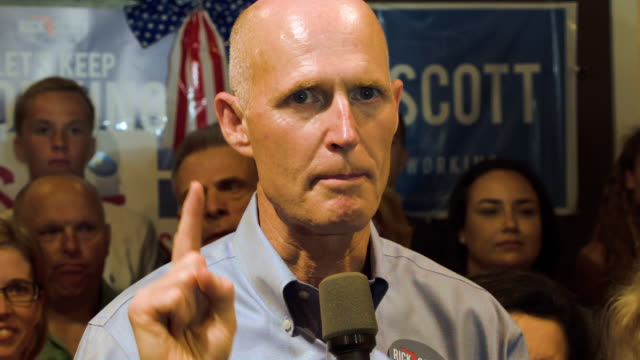florida governor rick scott speaks with new jersey governor chris christie as they make a campaign stop at a vero beach field office on october 16... - governor stock videos & royalty-free footage
