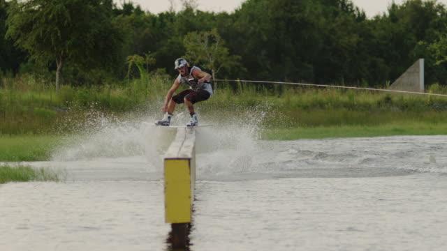 usa, florida, man on surfboard sliding on box - sliding stock videos & royalty-free footage