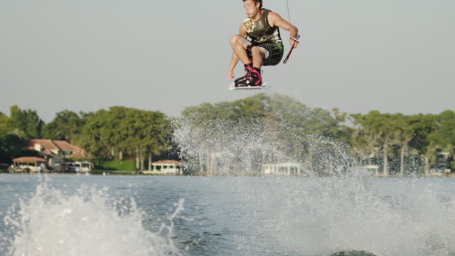 usa, florida, orlando, maitland lake, man wakeboarding - north america stock-videos und b-roll-filmmaterial