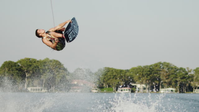 usa, florida, orlando, maitland lake, man wakeboarding - バク転点の映像素材/bロール