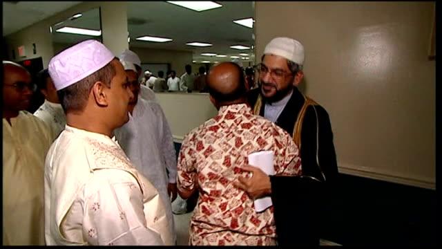 florida pastor calls off burning koran muslim men embracing each other at end of prayers - pastor stock videos & royalty-free footage