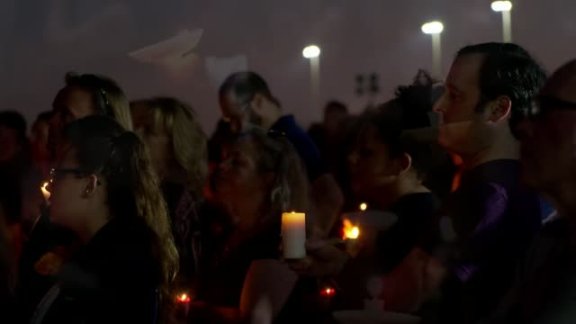 Pressure grows for gun control as Nikolas Cruz confesses to killings USA Florida Parkland Various of people attending vigil for the victims of the...