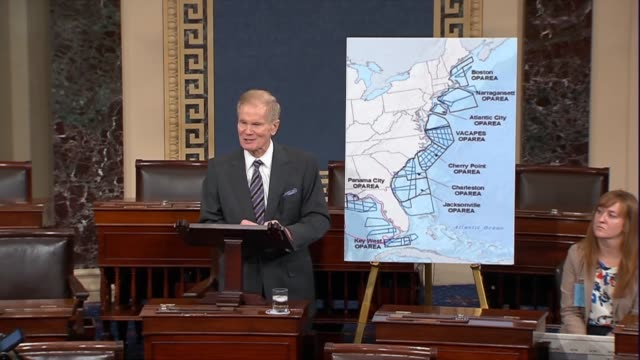 Florida Senator Bill Nelson points to a chart showing military zones in the Gulf of Mexico and along the Atlantic seaboard to point out that in...