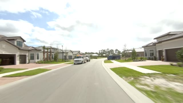 florida suburb i synced series rear view driving process plate - naples florida stock videos & royalty-free footage