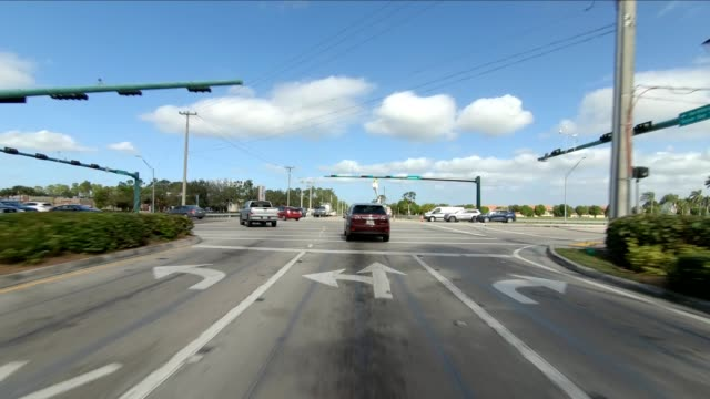 florida suburb xi synced series front view driving process plate - naples florida stock videos & royalty-free footage